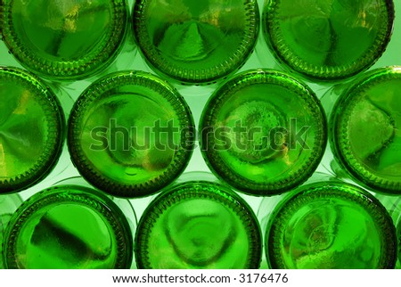 View of green beer bottles as seen from underneath