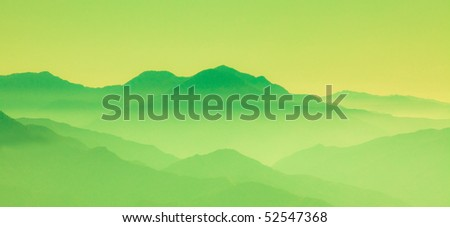 View of green mountains in the fog