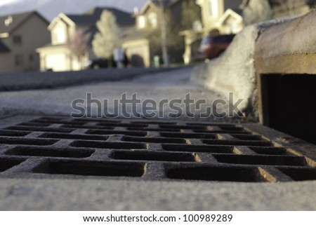 view of gutter and storm drain in an American neighborhood, slow the flow save H2O