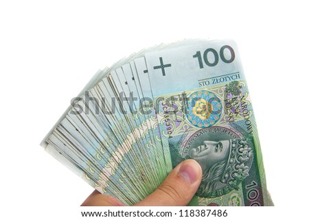 View of hand holding several polish one hundred banknotes