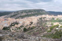 View of Hanged Houses (Casas Colgadas) and San Pablo bridge in Cuenca (Spain) taking from a hill.