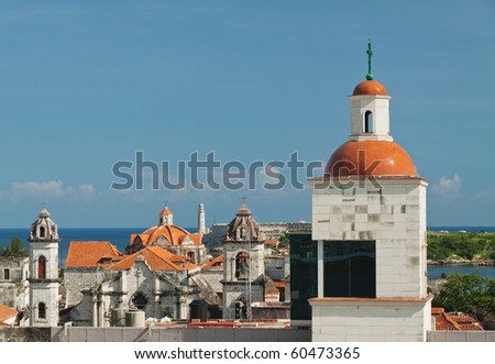 View of Havana historic center with lighthouse in El Morro Castle on background