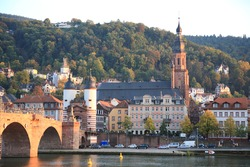 View of Heidelberg old town with Old Bridge over the river Neckar during sunset in autumn in Heidelberg, Germany