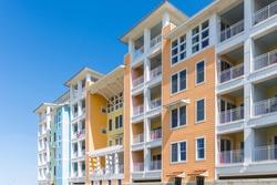 View of high rise apartment or condominium building, bright colors, balconies; Sandbridge Virginia USA