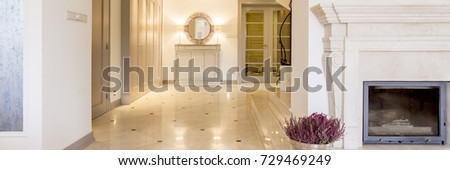View of home hallway with built-in wardrobe and a stylish mirror #729469249