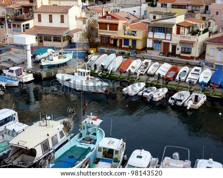 View of houses and small boats aligned at the port of Vallon des Auffes, Marseilles, France