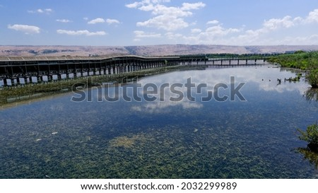 View of Hula Lake with the covered observation platform floating bridge, Hula Nature Reserve, Hula Valley, Upper Galilee, Northern Israel, Israel.