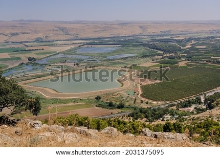 View of Hula Valley with Hula Nature Reserve and the Golan Heights in the background, as seen from Keren Naftali [Naftali's Horn] lookout on Naftali Heights in Northern Israel, Israel.