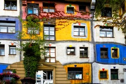 View of Hundertwasser house in Vienna, Austria. Idea and concept of Austrian artist Friedensreich Hundertwasser. Hundertwasserhaus apartment house is famous attraction Vienna, Austria