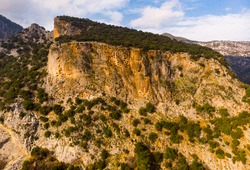 View of hundreds of burial tombs carved into mountainside in ancient Lycian city of Pinara in Turkey
