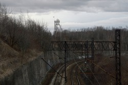 View of industrial tracks. In the background a mine shaft. Silesia Chorzow..
