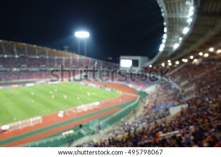 View of international football match in large stadium . Blurred picture