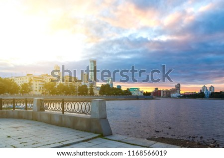 View of Iset river embankment on sunset. Yekaterinburg. The Urals. Russia