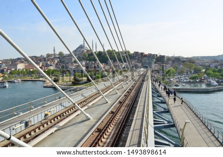 View of Istanbul from the bridge over the sea. Above sea with train. Stok fotoğraf ©