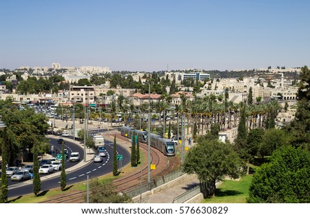 View of Jerusalem, Israel. Palm trees, cars, modern tram, traffic of the transport #576630829