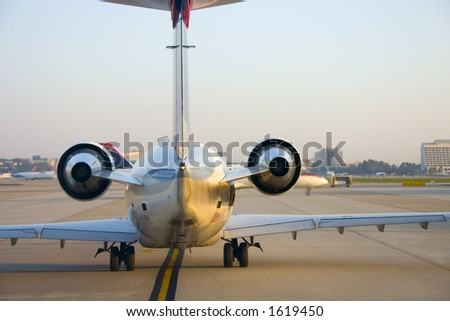 View of jet airplane from behind
