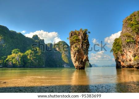 stock-photo-view-of-ko-tapu-island-near-phuket-from-wet-sandy-coast-95383699.jpg