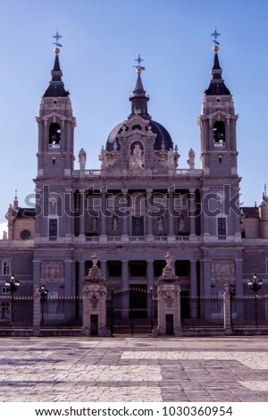 View of La Almudena Santa María's Cathedral in Madrid with Royal Palace of Madrid in Spain #1030360954