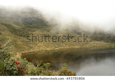 View of Lake Iguaque and low-hanging clouds in the Iguaque Fauna and Flora Sanctuary