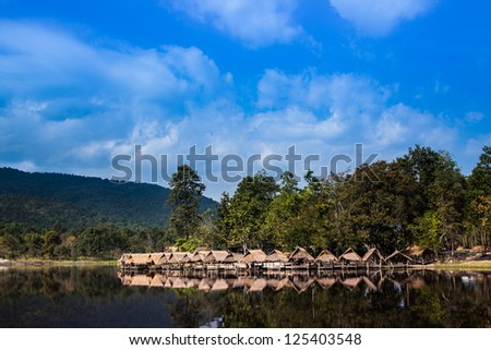 View of lake in a village in the northern province of Thailand  around with bamboo huts