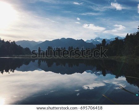 View of Lake Matheson at sunrise, New Zealand #695706418