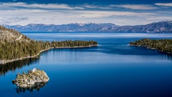 View of Lake Tahoe from near Emerald Bay, California, USA, including Fannette Island, in the end of the winter of 2018, covered with a very shallow layer of snow.