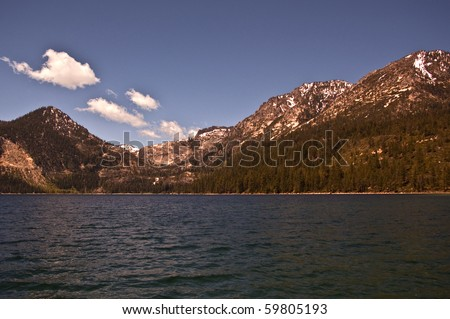 View of Lake Tahoe with its snow-capped mountains.  Lake Tahoe is a major recreation and travel spot in California and the western United States