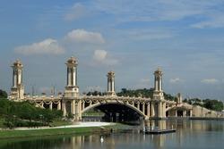 View of landmark site Putrajaya Bridge from the waters in Putrajaya, Malaysia