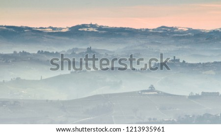 View of Langhe hills with vineyards in a foggy day from Verduno, Barolo area, Piedmont, Italy. #1213935961