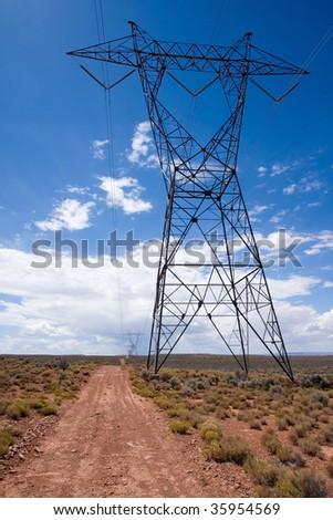 View of large electricity cable tower in northern Arizona desert.