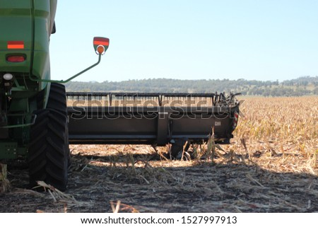 view of large scale farming harvesting equipment in an already harvested field in rural New South Wales, Australia #1527997913