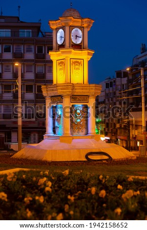 View of lighted small three storey clock tower decorated with columns and sculptures in center of Bursa in dusk, Turkey Stok fotoğraf ©