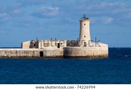 View of lighthouse in Grand Harbour (Valletta, Malta)