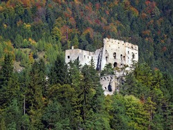 View of Likava Castle ruin surrounded by deep forests in autumn. This ruin is wide known because it is believed that it was used as prison for Juraj Janosik, famous Slovak outlaw (Slovak Robin Hood).