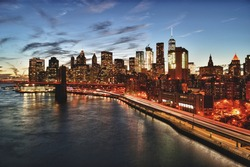 View of Lower Manhattan with Brooklyn Bridge and FDR Drive at sunset - HDR image.