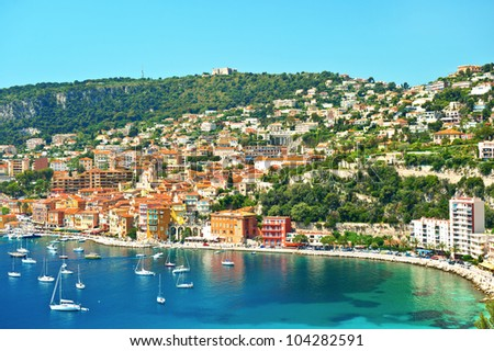 view of luxury resort and bay on sunny day. Villefranche-sur-Mer, Cote d'Azur, french reviera, near Nice and Monaco
