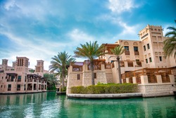 View of Madinat Jumeirah old style buildings from the canals, Dubai, UAE.