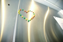 View of magnets in the shape of a heart on refrigerator