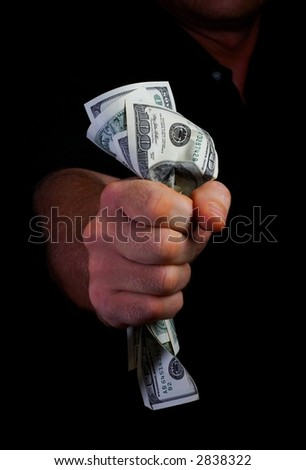 view of man's hand squeezing tightly some banknotes