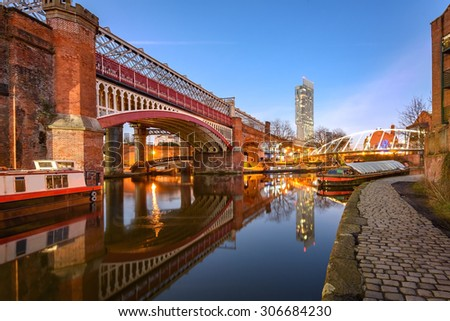 View of Manchester tallest building Beetham Tower, reflecting in Manchester Canal.