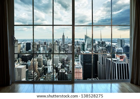 View of Manhattan New York City Skyline Buildings from High Rise Window - Beautiful Expensive Real Estate overlooking Empire State Building and Skyscrapers in Gorgeous Breathtaking Penthouse Cityscape
