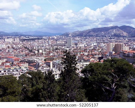 View of Marseilles city and all its red roofs, France, and with the mountain behind by cloudy weather