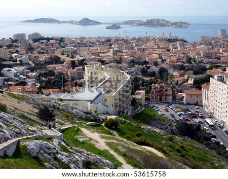 View of Marseilles city with lots of red roofs and Frioul islands in Mediterranean sea further, France