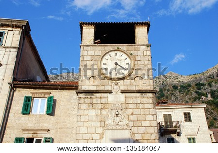 View of medieval clock tower, houses and surrounding mountains, Kotor, Montenegro.Kotor has one of the best preserved medieval old towns in the Adriatic and is a UNESCO world heritage site.