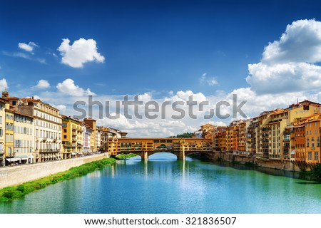 View of medieval stone bridge Ponte Vecchio and the Arno River from the Ponte Santa Trinita (Holy Trinity Bridge) in Florence, Tuscany, Italy. Florence is a popular tourist destination of Europe. stock photo