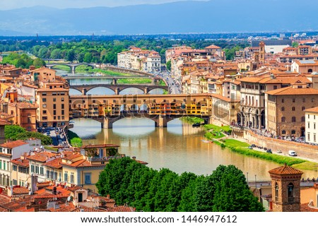 View of medieval stone bridge Ponte Vecchio over Arno river in Florence, Tuscany, Italy. Florence cityscape. Florence architecture and landmark. stock photo
