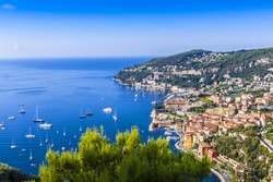 View of Mediterranean luxury resort and bay with yachts. Nice, Cote d'Azur, France. French Riviera - turquoise sea and perfect recreation.