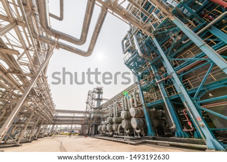 view of metal pipes of industrial plant outdoor at sunny day #1493192630