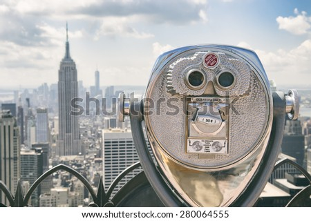 View of Midtown Manhattan New York City with coin-operated telescope on bright sunny day