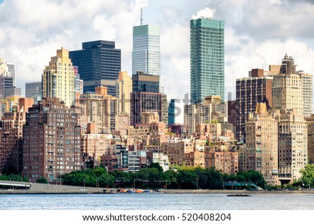 View of midtown Manhattan with several old and new apartment buildings